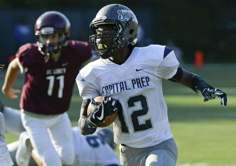 Capital Prep Navaughn Austin runs back a second half interception on St. luke's for a touchdown during a FAA varsity football game at Watson Field at Pedrick Stadium on Saturday, Sept. 16, 2017 in New Canaan, Connecticut. Capital Prep Harbor defeated St. Luke's 46-0. Photo: Matthew Brown / Hearst Connecticut Media / Stamford Advocate