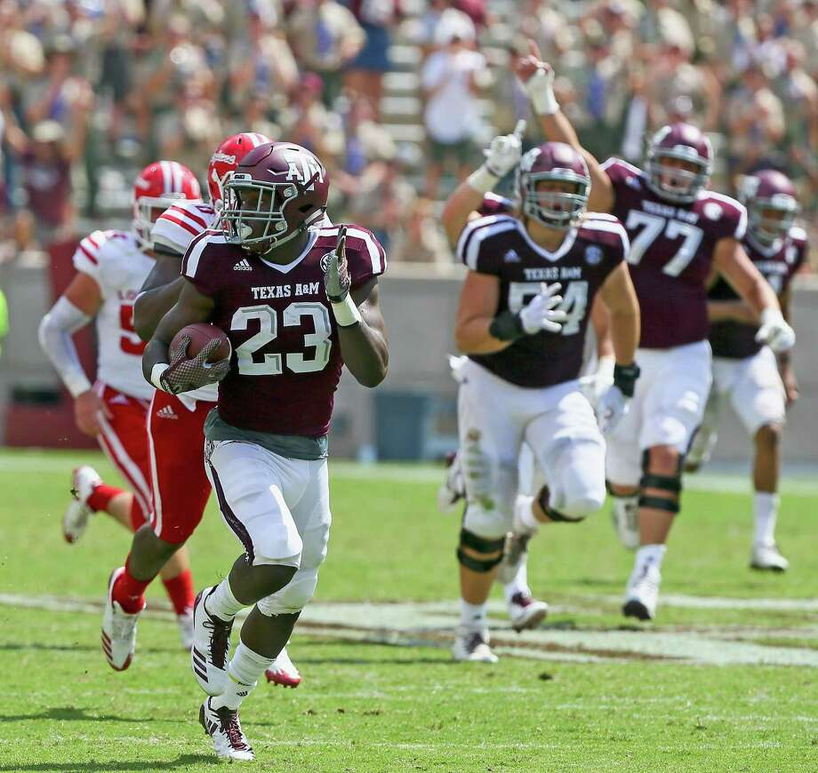 Texas A&M running back Jacob Kibodi rushes for a 67-yard touchdown in the fourth quarter Saturday against Louisiana-Lafayette. Kibodi finished with four carries for 101 yards. Photo: Bob Levey /Getty Images / 2017 Getty Images