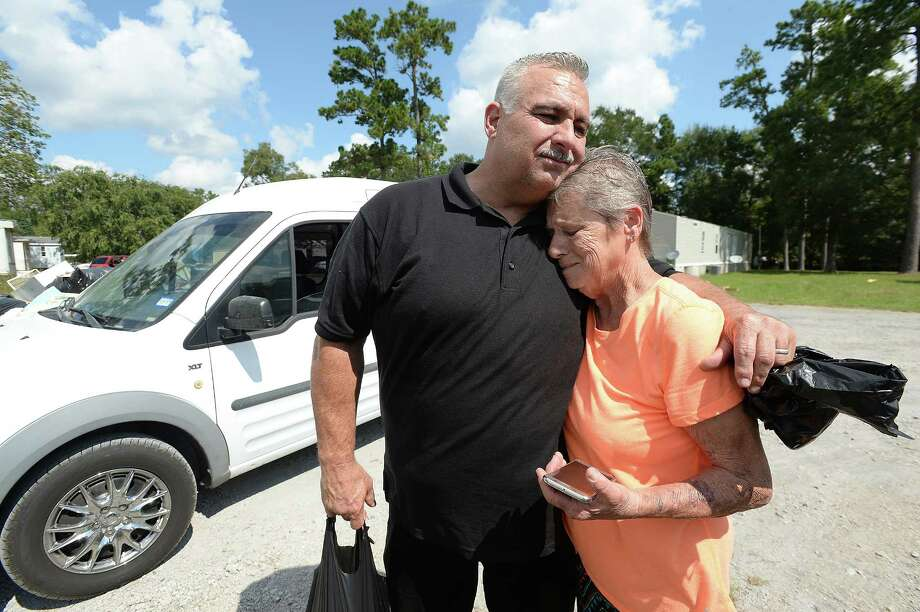Tuffy's owner Van Choate hugs Jean Gros, who becomes emotional after showing him photos of the flood waters that all but consumed her trailer home and vehicles, as well as those of her neighbors. With nowhere else to go and no transportation, he said the community is among the most in dire need of having food and supplies delivered to them. Saturday, he, family, and employees continued their delivery of whole seasoned, cooked rotisserie chickens to those in need after losing their homes and countless other personal affects to the flooding from Tropical Storm Harvey. Choate was contacted to help cook and deliver the chickens, which were donated by Ayrshire Farms in Virginia and arrived in Southeast Texas last week. The donation totaled 1200 whole organic chickens, 600 of which were delivered to Hardin County, and the remaining 600 to Orange County. Delivery began Friday, with his crew going door to door in flood affected neighborhoods, handing out the chickens, along with drinks and links, to residents. The work continued Saturday with stops at additional neighborhoods, including a heavily damaged trailer park, and the Iglesia Evangelica Church.  Photo taken Saturday, September 16, 2017 Kim Brent/The Enterprise Photo: Kim Brent / BEN