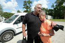 Tuffy's owner Van Choate hugs Jean Gros, who becomes emotional after showing him photos of the flood waters that all but consumed her trailer home and vehicles, as well as those of her neighbors. With nowhere else to go and no transportation, he said the community is among the most in dire need of having food and supplies delivered to them. Saturday, he, family, and employees continued their delivery of whole seasoned, cooked rotisserie chickens to those in need after losing their homes and countless other personal affects to the flooding from Tropical Storm Harvey. Choate was contacted to help cook and deliver the chickens, which were donated by Ayrshire Farms in Virginia and arrived in Southeast Texas last week. The donation totaled 1200 whole organic chickens, 600 of which were delivered to Hardin County, and the remaining 600 to Orange County. Delivery began Friday, with his crew going door to door in flood affected neighborhoods, handing out the chickens, along with drinks and links, to residents. The work continued Saturday with stops at additional neighborhoods, including a heavily damaged trailer park, and the Iglesia Evangelica Church.  Photo taken Saturday, September 16, 2017 Kim Brent/The Enterprise