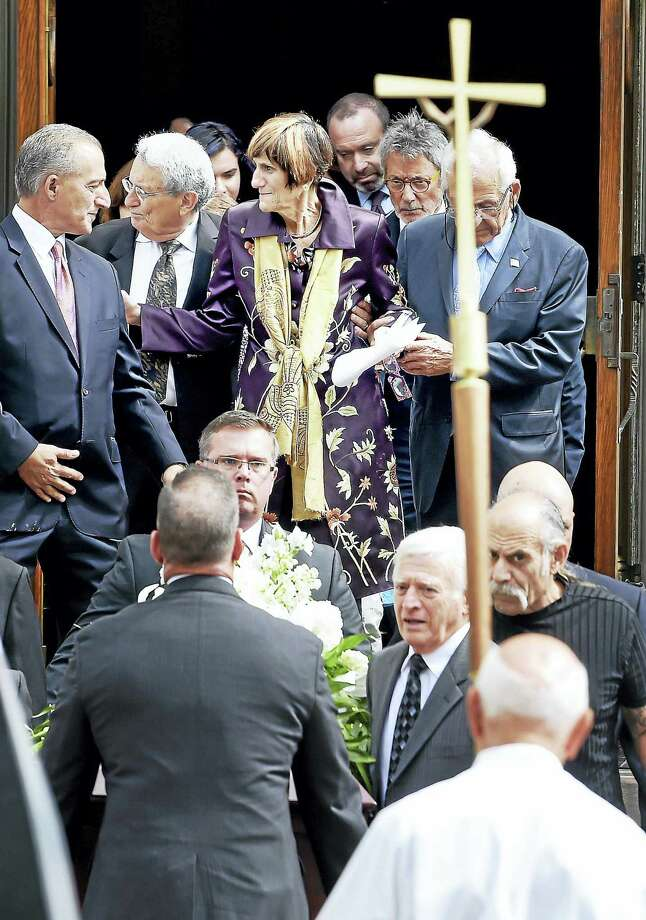 Arnold Gold / Hearst Connecticut Media U.S. Rep. Rosa DeLauro (center) walks with her husband, Stanley Greenberg (center left), behind the casket of her mother, Luisa DeLauro, at St. Michael's Church in the Wooster Square section of New Haven after a funeral service on Saturday. / New Haven Register