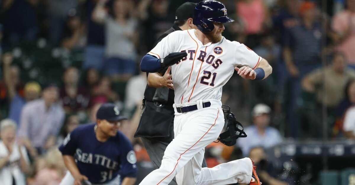 Houston Astros Derek Fisher (21) leaps home on George Springer's RBI single during the second inning of an MLB baseball game at Minute Maid Park, Saturday, Sept. 16, 2017, in Houston. ( Karen Warren / Houston Chronicle )