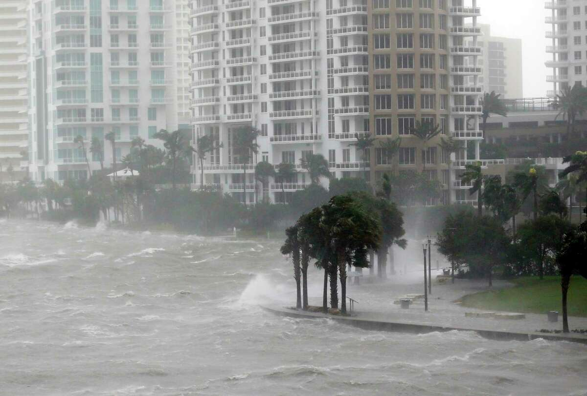 Waves crash over a seawall as Hurricane Irma rakes Miami recently. Rising sea levels and storms have failed to curb population growth along U.S. coasts in recent years, and coastline communities face the threat of more powerful storms in the future.