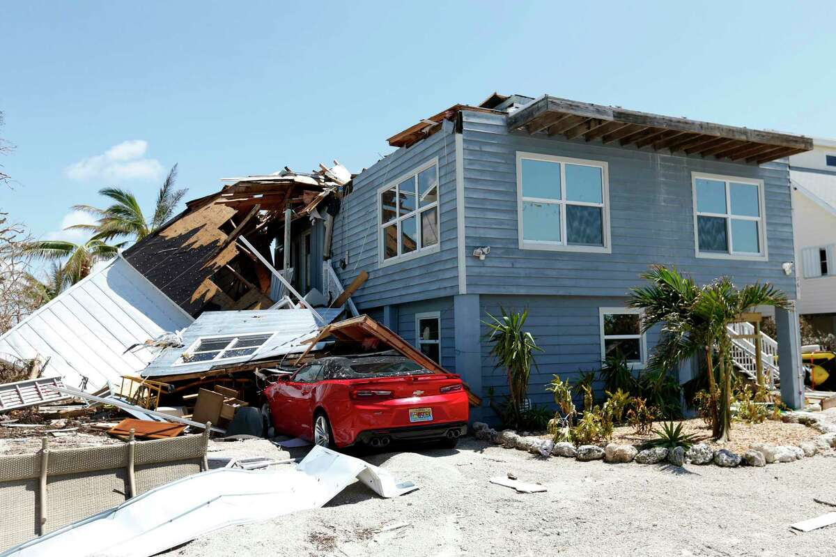 In this Sept. 13, 2017, photo, a house with its roof blown off by Hurricane Irma in Summerland Key, in the Florida Keys. Rising sea levels and fierce storms have failed to stop relentless population growth along U.S. coasts in recent years, a new Associated Press analysis shows. The latest punishing hurricanes scored bullÂ?'s-eyes on two of the countryÂ?'s fastest growing regions: coastal Texas around Houston and resort areas of southwest Florida. (AP Photo/Wilfredo Lee)