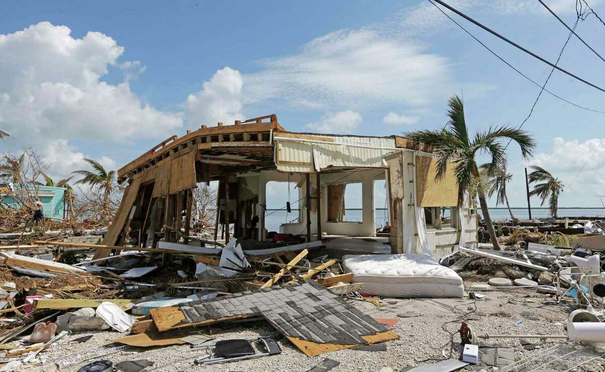 In this Sept. 13, 2017, photo, debris surrounds a destroyed structure in the aftermath of Hurricane Irma in Big Pine Key, Fla. Rising sea levels and fierce storms have failed to stop relentless population growth along U.S. coasts in recent years, a new Associated Press analysis shows. The latest punishing hurricanes scored bullÂ?'s-eyes on two of the countryÂ?'s fastest growing regions: coastal Texas around Houston and resort areas of southwest Florida. (AP Photo/Alan Diaz)