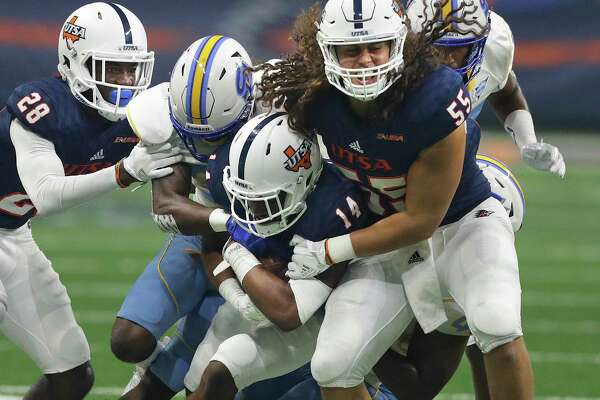Roadrunner defensive back C.J. Levine gets some running help from JosiahTauaefo as he chugs along with a first quarter interception as UTSA  hosts Southern at the Alamodome on September 16, 2017.