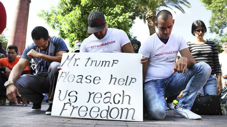 Cubans stranded in Nuevo Laredo, Mexico kneel in prayer before a rally and marching from Plaza Juarez to the International Bridge, on Saturday, April. 8, 2017. Photo: Bob Owen, Staff / San Antonio Express-News / ©2017 San Antonio Express-News