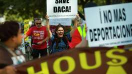 University of Houston Clear Lake professor Angela Miller chants and marches in support of DACA recipients Saturday in Moody Park.