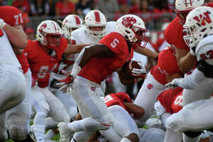 Katy senior running back Josh Oglesby (5) takes off on his 80-yard touchdown run against The Woodlands in the 2nd quarter of their season opening matchup at Legacy Stadium in Katy on Saturday, Sept. 16, 2017.  (Photo by Jerry Baker/Freelance)