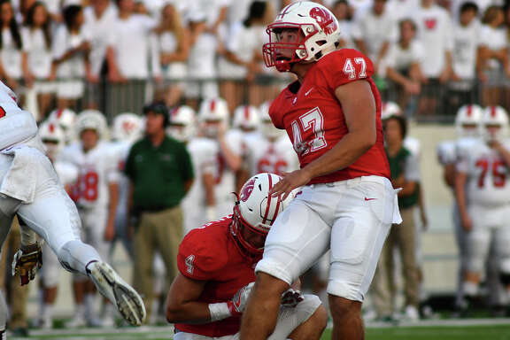 Katy senior placekicker Seth Small (47), with the hold from teammate Kaden Gonzales (4), attempts a field goal against The Woodlands late in the 2nd quarter of their season opening matchup at Legacy Stadium in Katy on Saturday, Sept. 16, 2017.  (Photo by Jerry Baker/Freelance)
