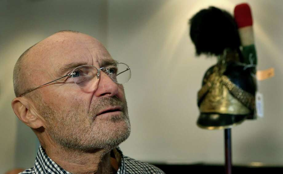Phil Collins speaks about some of the historical items he donated to the Alamo, including a Mexican Army helmet (at right) in 2014. Photo: Bob Owen /San Antonio Express-News / © 2014 San Antonio Express-News