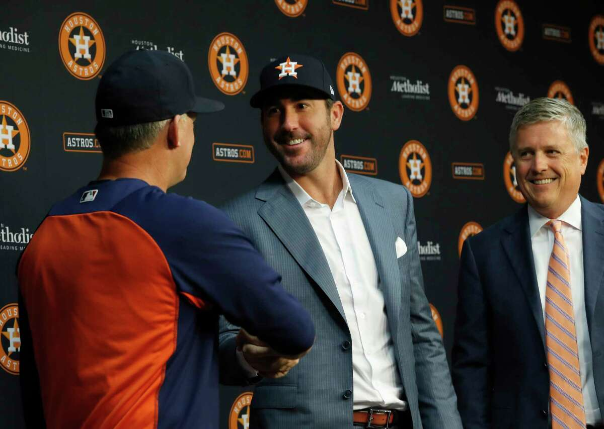 Flanked by Astros manager A.J. Hinch, left, and GM Jeff Luhnow, Justin Verlander was officially introduced as an Astro on Sept. 3 at Minute Maid Park.