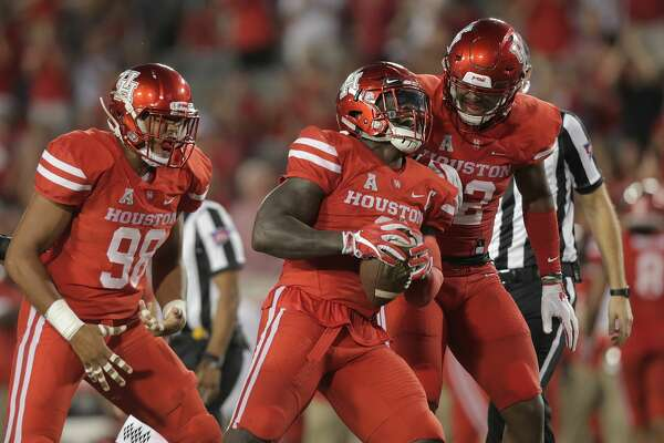 Houston Cougars linebacker Matthew Adams (9) celebrates a fumble recover in the first quarter against Rice Owls  at TDECU Stadium on Saturday, Sept. 16, 2017, in Houston. ( Elizabeth Conley / Houston Chronicle )