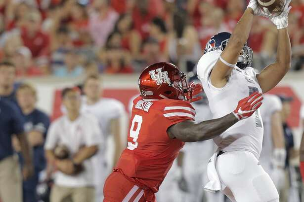 Rice Owls wide receiver Jordan Myers (7) catches but can't hold onto a pass as Houston Cougars linebacker Matthew Adams (9) knocks the ball away during the second quarter at TDECU Stadium on Saturday, Sept. 16, 2017, in Houston. ( Elizabeth Conley / Houston Chronicle )