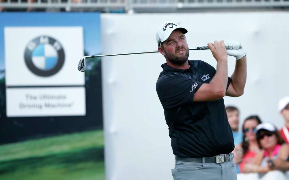 Marc Leishman watches his tee shot on the 17th hole during the third round of the BMW Championship golf tournament at Conway Farms Golf Club, Saturday, Sept. 16, 2017, in Lake Forest, Ill. (AP Photo/Charles Rex Arbogast) ORG XMIT: ILCA122 Photo: Charles Rex Arbogast / Copyright 2017 The Associated Press. All rights reserved.