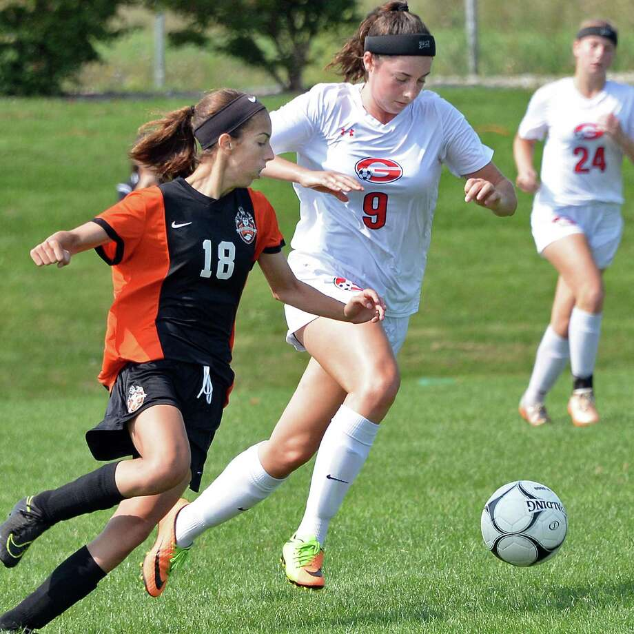 Mohonasen's #18 Kyra McCarthy, left, and Guilderland's #9 Christine Fish chase the ball at midfield during Saturday's game Sept. 16, 2017 in Guilderland, NY.  (John Carl D'Annibale / Times Union) Photo: John Carl D'Annibale / 40041560A