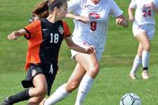 Mohonasen's #18 Kyra McCarthy, left, and Guilderland's #9 Christine Fish chase the ball at midfield during Saturday's game Sept. 16, 2017 in Guilderland, NY.  (John Carl D'Annibale / Times Union)