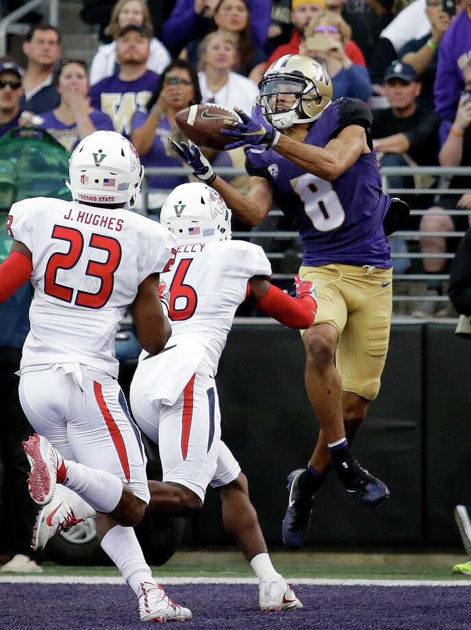 Washington's Dante Pettis (8) catches a touchdown pass in the end zone as a pair of Fresno State defenders move in in the first half of an NCAA college football game, Saturday, Sept. 16, 2017, in Seattle. (AP Photo/Elaine Thompson) Photo: Elaine Thompson/AP