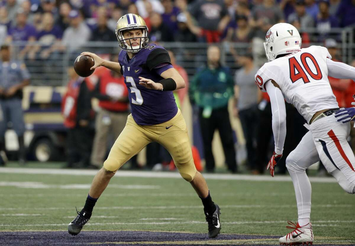 Washington quarterback Jake Browning (3) looks to throw as Fresno State's Justin Green gives chase during the first half of an NCAA college football game Saturday, Sept. 16, 2017, in Seattle. (AP Photo/Elaine Thompson)