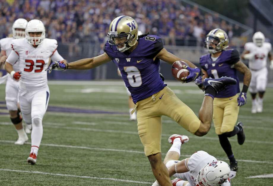 """Punt-return Pettis does it againConventional wisdom would have told Fresno State not to punt to UW's Dante Pettis, who entered Saturday's game as the Pac-12's most decorated return man. But nothing's truly conventional in a sport in which one team pays another $1 million to come get pummeled, so naturally the Bulldogs booted it to Pettis early in the first quarter. The result: a 77-yard touchdown – the eighth of his career, tying the NCAA record, and his third in as many games.""""On most of them, I don't have to set up the blocks too much, I just have to wait for the blocks to unfold and I just run off of them,"""" he said, explaining the mastery that has become a Pettis punt return. """"Guys do a good job of actually working hard and blocking. They make it easy for me.""""He's making it look easy, too. And even he is surprised that teams are still electing to kick to him.""""We'll see next week what happens (against Colorado),"""" he said, laughing. """"Hopefully they keep kicking to me."""" Photo: Elaine Thompson/AP"""