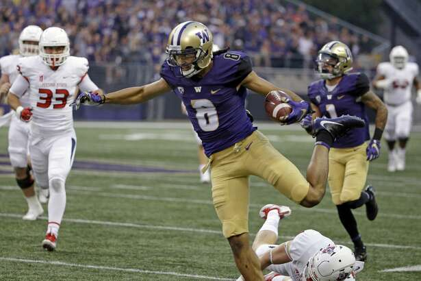 Washington's Dante Pettis (8) eludes a tackle on his punt return for a touchdown against Fresno State in the first half of an NCAA college football game, Saturday, Sept. 16, 2017, in Seattle. (AP Photo/Elaine Thompson)