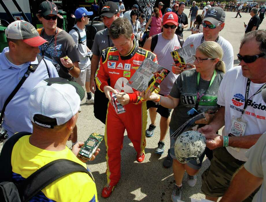 JOLIET, IL - SEPTEMBER 16:  Dale Earnhardt Jr., driver of the #88 AXALTA Chevrolet, signs autographs for fans during practice for the Monster Energy NASCAR Cup Series Tales of the Turtles 400 at Chicagoland Speedway on September 16, 2017 in Joliet, Illinois.  (Photo by Brian Lawdermilk/Getty Images) ORG XMIT: 775017547 Photo: Brian Lawdermilk / 2017 Getty Images