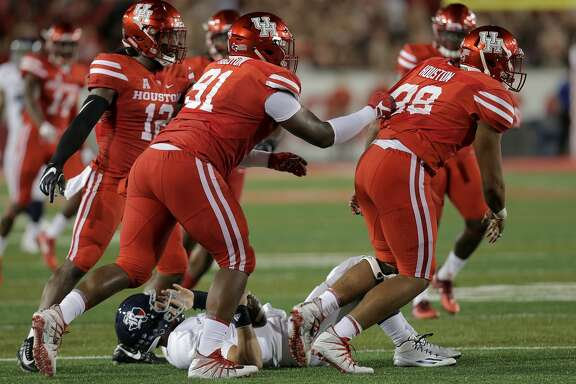 Rice Owls quarterback Sam Glaesmann (4) is taken down by most of Houston's defensive line in the first inning at TDECU Stadium on Saturday, Sept. 16, 2017, in Houston. ( Elizabeth Conley / Houston Chronicle )