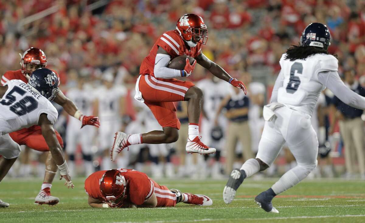 Houston Cougars wide receiver John Leday (85) jumps over his teammate for extra yards in the second quarter agianst Rice Owls at TDECU Stadium on Saturday, Sept. 16, 2017, in Houston. ( Elizabeth Conley / Houston Chronicle )