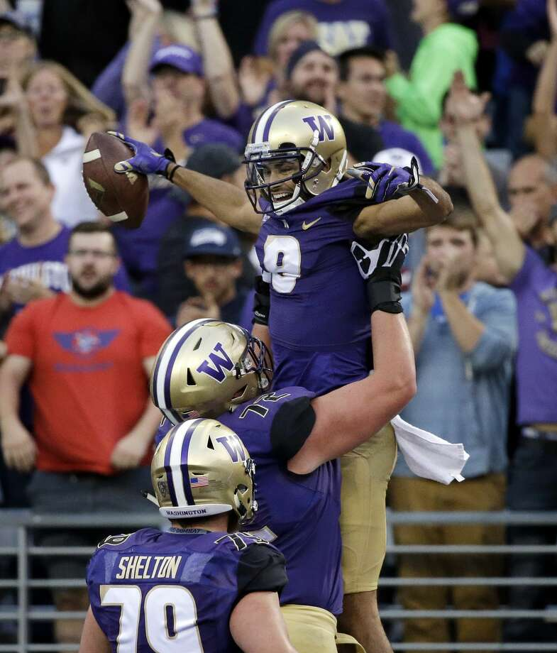 Washington's Dante Pettis is lifted up by teammate Trey Adams after Pettis scored a touchdown on a pass reception against Fresno State in the first half of an NCAA college football game, Saturday, Sept. 16, 2017, in Seattle. (AP Photo/Elaine Thompson) Photo: Elaine Thompson/AP