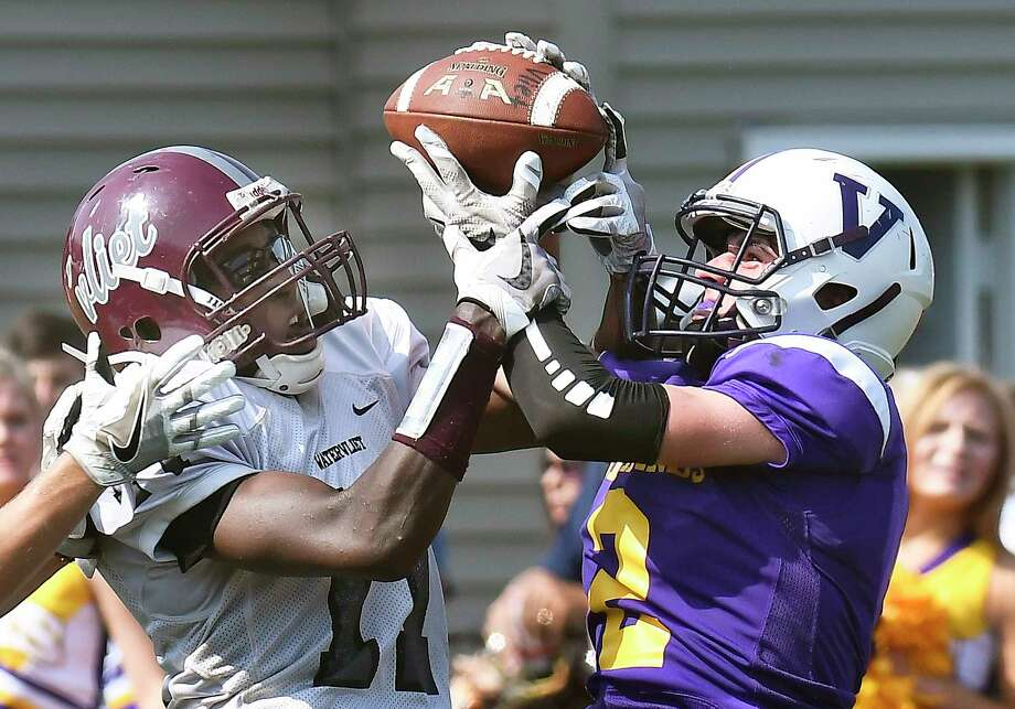 Voorheesville's Ian Owens breaks up a pass intended Watervliet's Matt Bell, left, during a Section II Class C high school football game in Voorheesville, N.Y., Saturday, Sept. 16, 2017. (Hans Pennink / Special to the Times Union) ORG XMIT: HP101 Photo: Hans Pennink / Hans Pennink