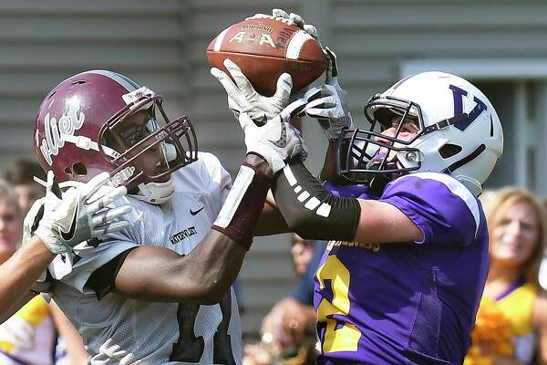 Voorheesville's Ian Owens breaks up a pass intended Watervliet's Matt Bell, left, during a Section II Class C high school football game in Voorheesville, N.Y., Saturday, Sept. 16, 2017. (Hans Pennink / Special to the Times Union) ORG XMIT: HP101
