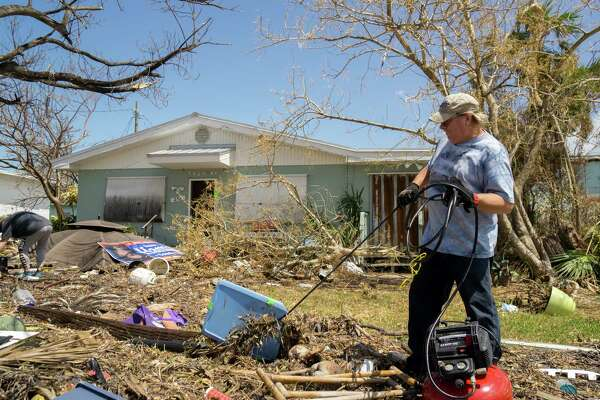 MARATHON, FL - SEPTEMBER 16: Tim Thompson, Minister of the Marathon Church of Christ,  clears debris in front of the house he rents next to his church after arriving from Homestead where he and his wife Kathy evacuated to before Hurricane Irma made landfall on September 16, 2017 in Marathon, Florida. Many places in the Keys still lack water, electricity or mobile phone service and residents are still not permitted to go further south than Islamorada. The Federal Emergency Managment Agency has reported that 25-percent of all homes in the Florida Keys were destroyed and 65-percent sustained major damage when they took a direct hit from Hurricane Irma.  (Photo by Angel Valentin/Getty Images) ORG XMIT: 775044685