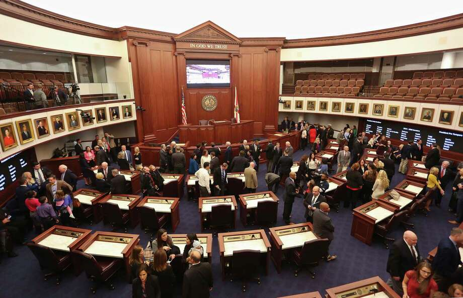 ADVANCE FOR USE SUNDAY, SEPT. 17, 2017 AND THEREAFTER-FILE - In this Monday, Nov. 21, 2016 file photo, visitors, Florida senators and their staff members look at the new Florida Senate chamber in Tallahassee, Fla., reopening after a $6 million upgrade. Florida has some of the nation's strongest open-records and open-meetings laws, but that did not stop lawmakers from trying to tinker with them. In 2017, they passed 19 new exemptions to the Sunshine Law, the second most in at least two decades. (Scott Keeler/Tampa Bay Times via AP) ORG XMIT: FLPET473 Photo: Scott Keeler / Tampa Bay Times
