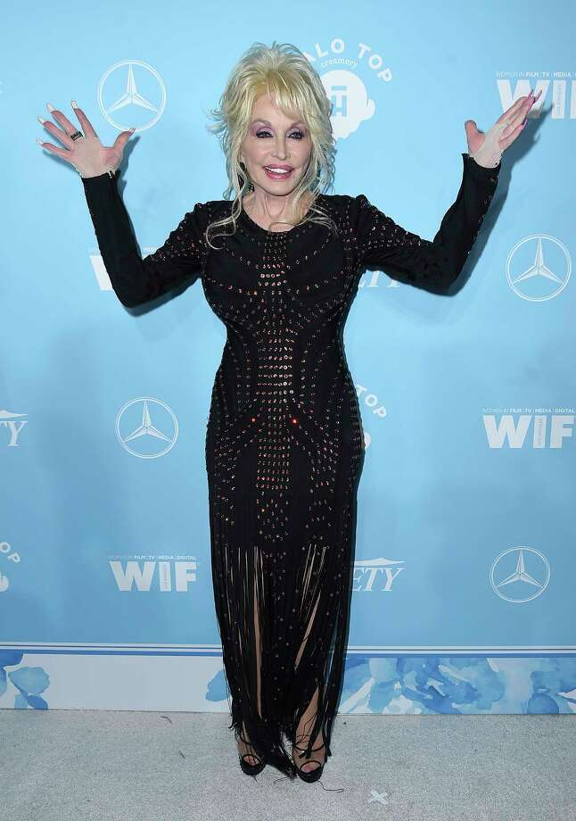 Dolly Parton arrives at the 69th Primetime Emmy Awards Variety and Women in Film pre-Emmy celebration on Friday, Sept. 15, 2017 in Los Angeles. (Photo by Jordan Strauss/Invision/AP) ORG XMIT: CAJS114 Photo: Jordan Strauss / 2017 Invision