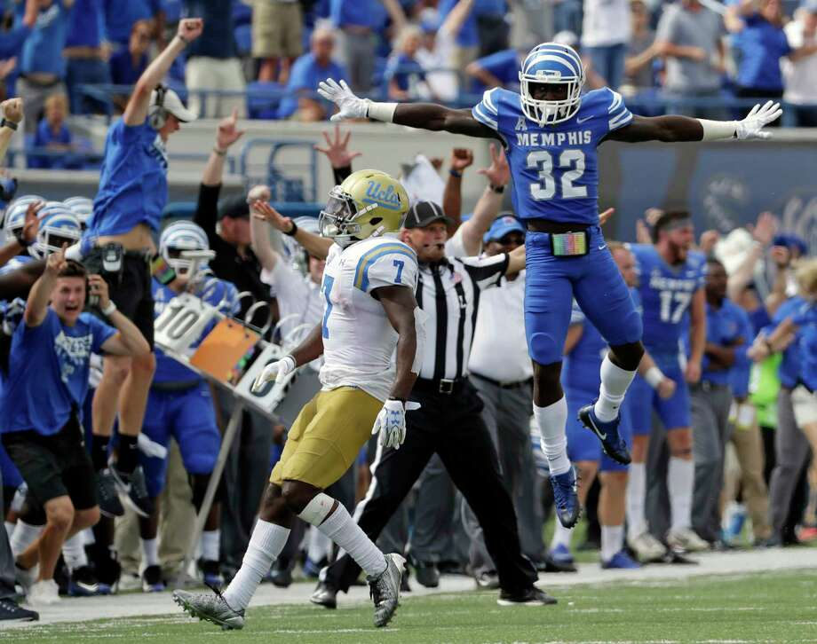 Memphis defensive back Jacobi Francis (32) celebrates after he broke up a pass intended for UCLA wide receiver Darren Andrews (7) to seal a 48-45 win for Memphis in the closing seconds of the fourth quarter of an NCAA college football game Saturday, Sept. 16, 2017, in Memphis, Tenn. (AP Photo/Mark Humphrey) ORG XMIT: TNMH122 Photo: Mark Humphrey / Copyright 2017 The Associated Press. All rights reserved.