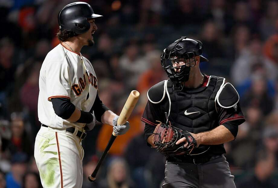 Jarrett Parker #6 of the San Francisco Giants reacts after swinging at a pitch in the dirt for the third strike as catcher Chris Iannetta #8 of the Arizona Diamondbacks prepairs to tag him out to end the six inning at AT&T Park on September 16, 2017 in San Francisco, California. (Photo by Thearon W. Henderson/Getty Images) Photo: Thearon W. Henderson, Getty Images
