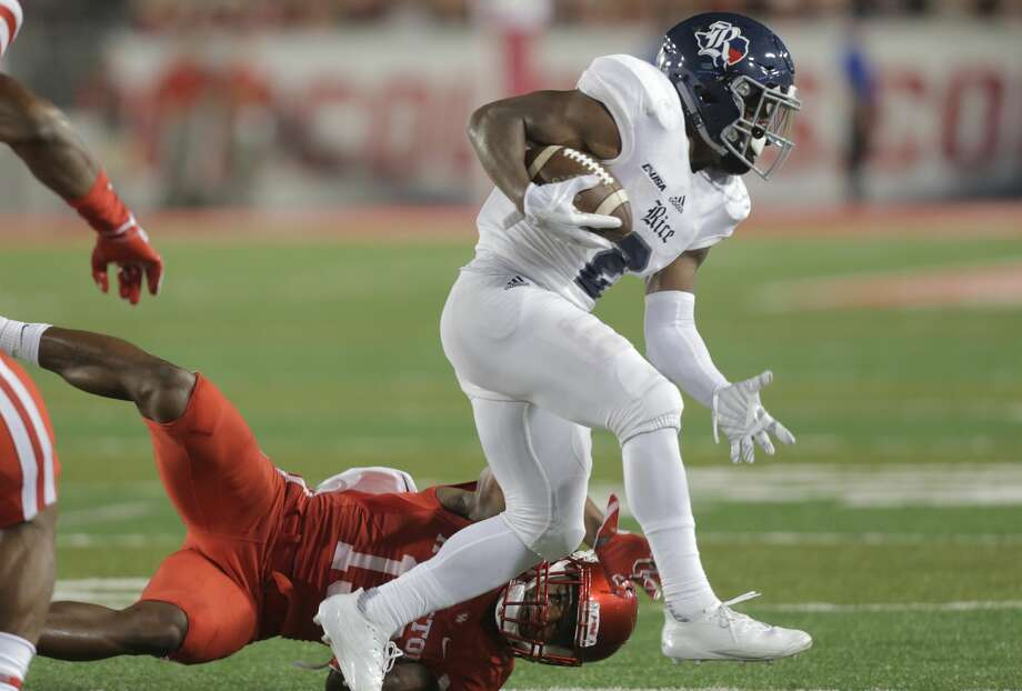 Rice Owls running back Austin Walter (2) avoids a tackle for a first down in the fourth quarter at TDECU Stadium on Saturday, Sept. 16, 2017, in Houston. Houston won the game  38-3 over Rice. ( Elizabeth Conley / Houston Chronicle ) Photo: Elizabeth Conley/Houston Chronicle