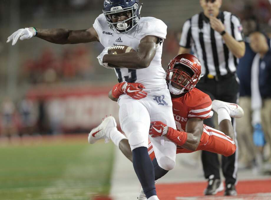 Rice Owls running back Emmanuel Esukpa (33) is taken out of bounds by Houston Cougars safety Darius Gilbert (29) in the fourth quarter at TDECU Stadium on Saturday, Sept. 16, 2017, in Houston. Houston won the game  38-3 over Rice. ( Elizabeth Conley / Houston Chronicle ) Photo: Elizabeth Conley/Houston Chronicle
