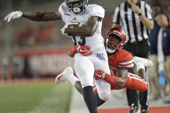 Rice Owls running back Emmanuel Esukpa (33) is taken out of bounds by Houston Cougars safety Darius Gilbert (29) in the fourth quarter at TDECU Stadium on Saturday, Sept. 16, 2017, in Houston. Houston won the game  38-3 over Rice. ( Elizabeth Conley / Houston Chronicle )