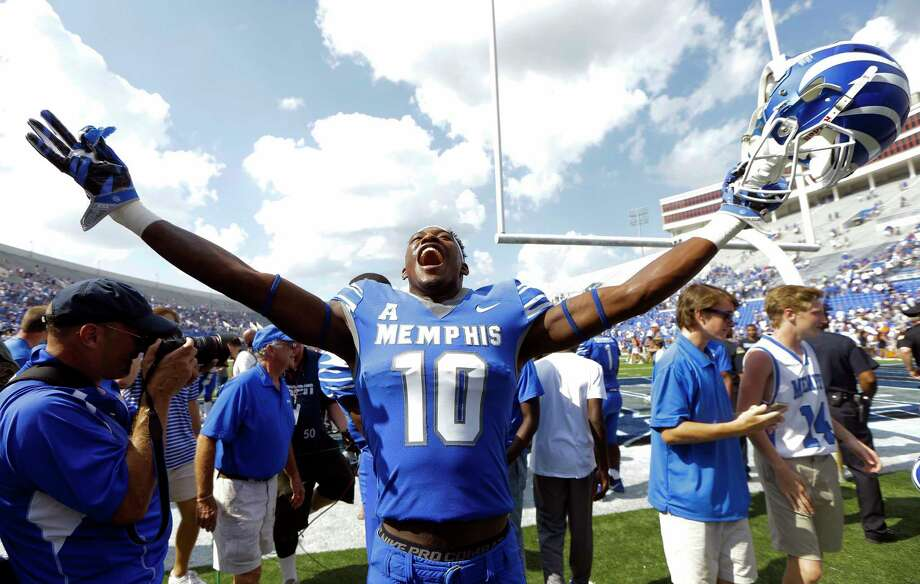 Memphis wide receiver Damonte Coxie celebrates as he leaves the field after Memphis beat UCLA 48-45 in an NCAA college football game Saturday, Sept. 16, 2017, in Memphis, Tenn. (AP Photo/Mark Humphrey) Photo: Mark Humphrey, STF / Copyright 2017 The Associated Press. All rights reserved.
