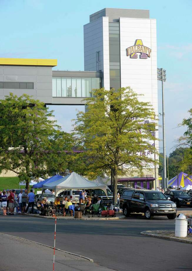 Fans tailgate in the parking lot before the start of an NCAA college football game between the Albany Great Danes and the Monmouth Hawks on Saturday, Sept. 16, 2017, in Albany, N.Y. (Hans Pennink / Special to the Times Union) ORG XMIT: HP117 Photo: Hans Pennink / Hans Pennink