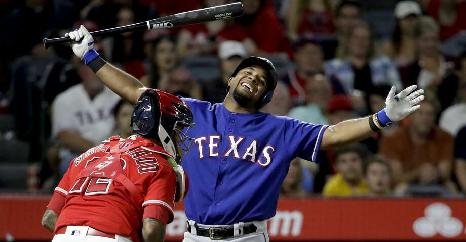 Texas Rangers' Elvis Andrus, right, reacts after striking out, next to Los Angeles Angels catcher Martin Maldonado during the ninth inning of a baseball game in Anaheim, Calif., Saturday, Sept. 16, 2017. (AP Photo/Chris Carlson) Photo: Chris Carlson/Associated Press