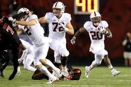 SAN DIEGO, CA - SEPTEMBER 16:   Walker Little #72 blocks against the Stanford Cardinal Bryce Love #20 of the Stanford Cardinal runs for a touchdown during the first half of a game against the San Diego State Aztecs at Qualcomm Stadium on September 16, 2017 in San Diego, California.  (Photo by Sean M. Haffey/Getty Images)