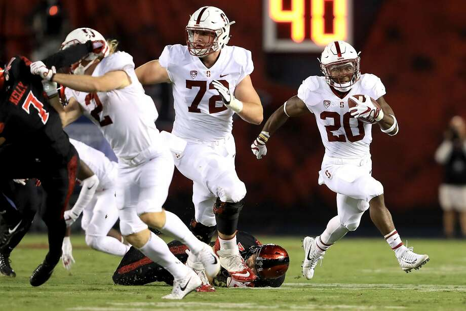 SAN DIEGO, CA - SEPTEMBER 16:   Walker Little #72 blocks against the Stanford Cardinal Bryce Love #20 of the Stanford Cardinal runs for a touchdown during the first half of a game against the San Diego State Aztecs at Qualcomm Stadium on September 16, 2017 in San Diego, California.  (Photo by Sean M. Haffey/Getty Images) Photo: Sean M. Haffey, Getty Images