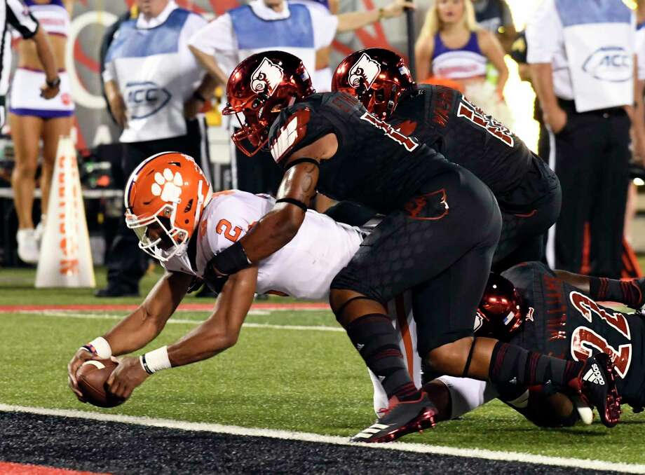 Clemson quarterback Kelly Bryant (2) is brought down by Louisville's Dorian Etheridge, front right, and Trumaine Washington (15) as he crosses the goal line during the first half of an NCAA college football game, Saturday, Sept. 16, 2017, in Louisville, Ky. (AP Photo/Timothy D. Easley) ORG XMIT: KYTE101 Photo: Timothy D. Easley / FR43398 AP