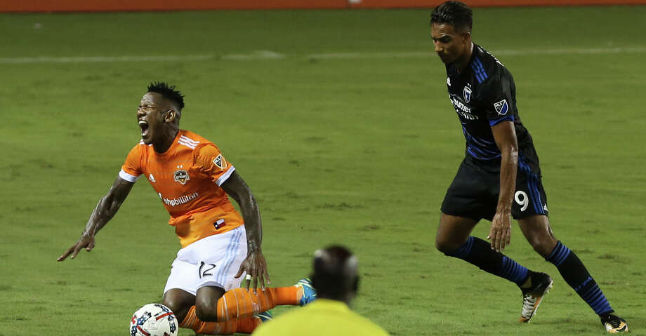 Houston Dynamo forward Romell Quioto (12) reacts to being fouled by San Jose Earthquakes forward Danny Hoesen (9) during the first half of the game at BBVA Compass Stadium Saturday, Aug. 12, 2017, in Houston. ( Yi-Chin Lee / Houston Chronicle ) Photo: Yi-Chin Lee/Houston Chronicle
