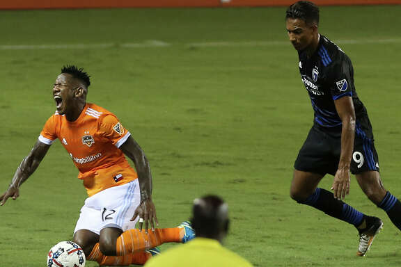 Houston Dynamo forward Romell Quioto (12) reacts to being fouled by San Jose Earthquakes forward Danny Hoesen (9) during the first half of the game at BBVA Compass Stadium Saturday, Aug. 12, 2017, in Houston. ( Yi-Chin Lee / Houston Chronicle )