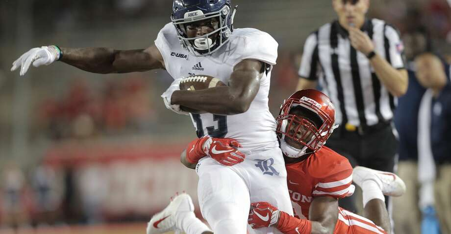 PHOTOS: UH 38, Rice 3Rice Owls running back Emmanuel Esukpa (33) is taken out of bounds by Houston Cougars safety Darius Gilbert (29) in the fourth quarter at TDECU Stadium on Saturday, Sept. 16, 2017, in Houston. Houston won the game  38-3 over Rice. ( Elizabeth Conley / Houston Chronicle )Browse through the photos to see action from the Bayou Bucket game on Saturday. Photo: Elizabeth Conley/Houston Chronicle