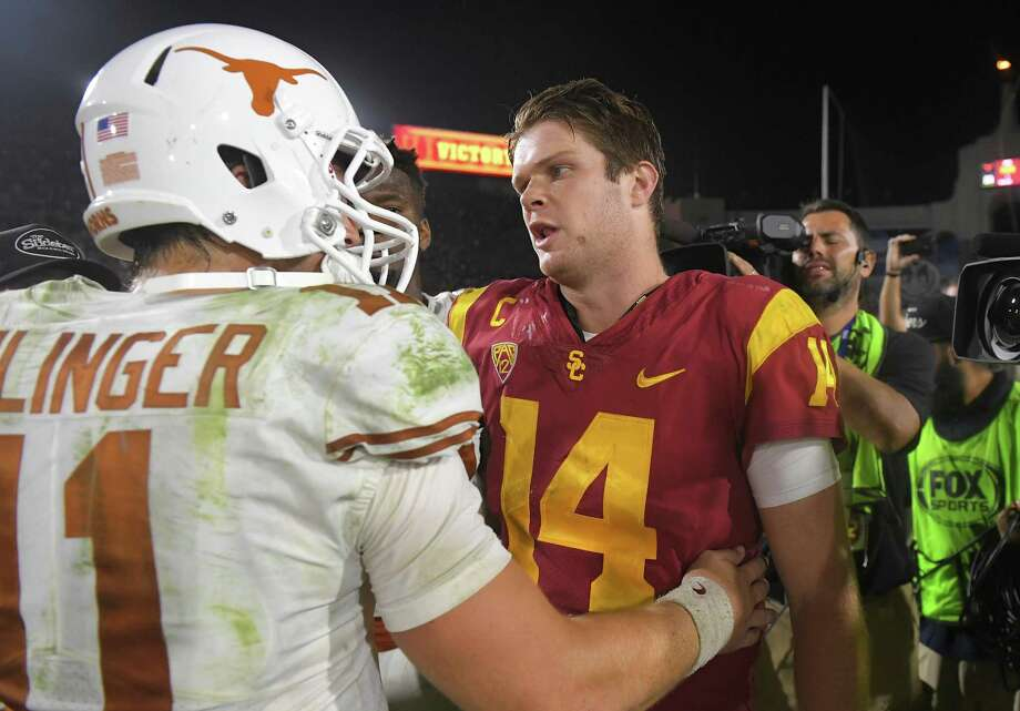 Texas quarterback Sam Ehlinger, left, and Southern California quarterback Sam Darnold greet each other after an NCAA college football game, Saturday, Sept. 16, 2017, in Los Angeles. USC won 27-24 in two overtimes. (AP Photo/Mark J. Terrill) Photo: Mark J. Terrill, STF / Associated Press / Copyright 2017 The Associated Press. All rights reserved.