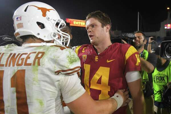 Texas quarterback Sam Ehlinger, left, and Southern California quarterback Sam Darnold greet each other after an NCAA college football game, Saturday, Sept. 16, 2017, in Los Angeles. USC won 27-24 in two overtimes. (AP Photo/Mark J. Terrill)